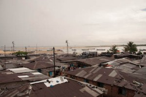 Looking over the rooftops of the densely packed neighborhood of West Point, Monrovia, Liberia