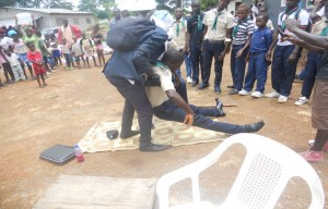 Liberian Scouts demonstrate how to handle a sick Ebola person