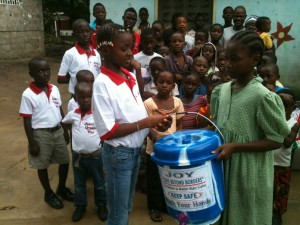The-symbolic-presentation-one-of-the-buckets-to-representative-of-the-orphanage.