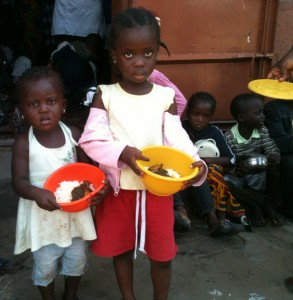 Children with food in hand after being served