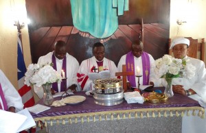 Bishop Innis presiding over Communion Service at the UMC Liberia Women Annual Session upon his return from Ghana