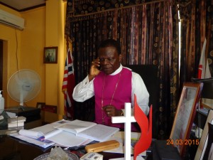 Bishop John Innis of UMC Liberia on the phone with Rev. James Kaifunbah of Buduburam UMC in Ghana