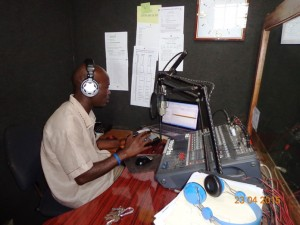 Radio Station Manager, Edward Massaquoi in studio with some of the equipment