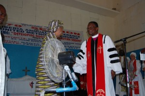 Bishop Innis greeting President Sirleaf at the Liberia Annual Conference.