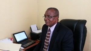 Acting President of UMU Johnson N. Gwaikolo working from his business and finance office