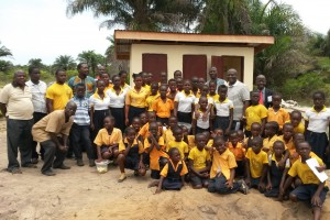 United Methodist School students and church officials posed for a photo in front of the modern toilet facility