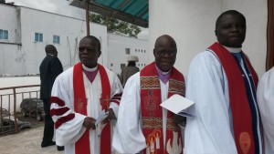 Bishop Arthur Kulah 2nd from left processing for the turning over cermony
