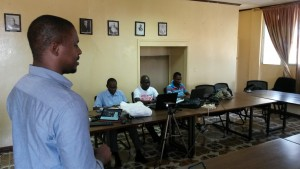 UMConnect  traniner, Ndzulo Tueche Joe leading training in Liberia. Seated (l-r) - MacArthur Hill, Edward Massaquoi, Michael Boeglay