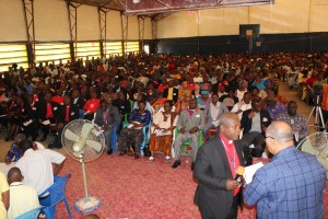 Conference members listening to the presentation on the five amendments with Bishop John K. Yambasu (3rd from right)