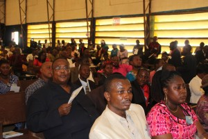 Members of the conference including Rev. Dr. Emmanuel Bailey listening to the Episcopal Address