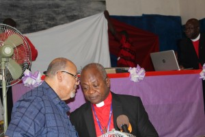 Rudolph Merab (l) and Rev. Dr. Julius Nelson leading the discussions on the five proposed amendments with Rev. Dr. Jerry Kulah on the computer