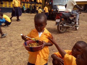 One of the students of the Siaffa-keh United Methodist School eating before going to receive his Christmas gifts